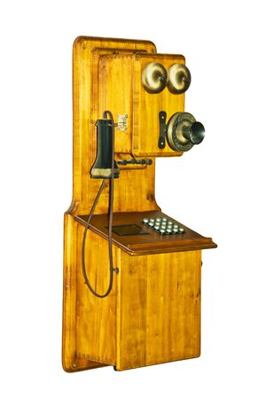 Old wooden phone with an acoustical pipe photo