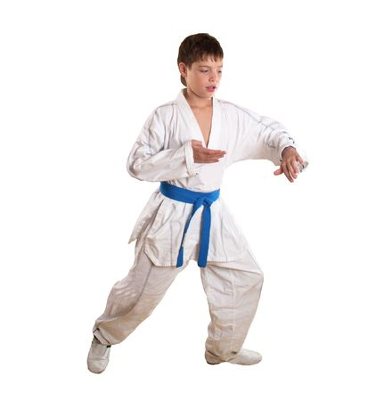 The boy does exercise on taekwondo on a white background is isolated  Stock Photo