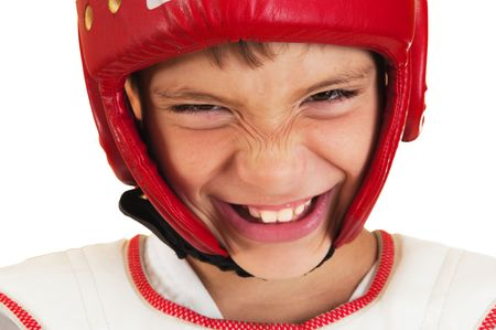 The boy in a sports helmet smiles on a white background