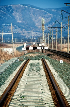 deadlock: Railway deadlock in the winter against mountains