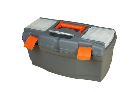 Plastic box of tools on light background. Studio work. Stock Photo - 8558284