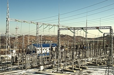 generating station: electrical transformers  sub-station on the blue background