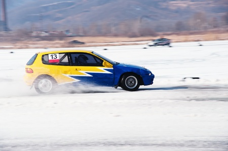Car at the winter rally in russia photo