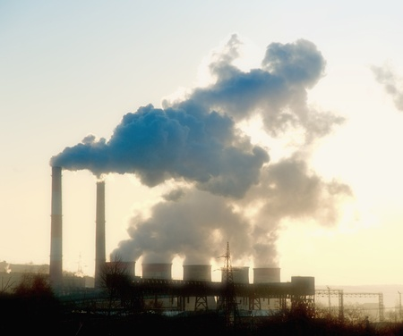 greenhouse gas: industrial site with smoking pipes global warming concept