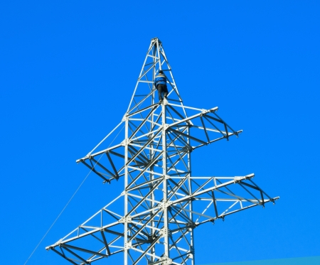 Power linemen at work up on a pylon tower. Stock Photo
