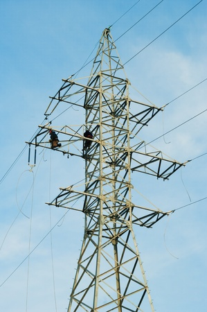 linemen: Power linemen at work up on a pylon tower. Stock Photo