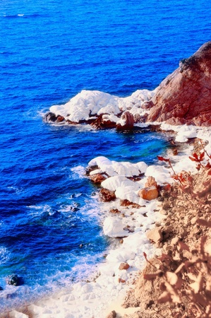 Sea rocks in ice a Japanese sea Stock Photo - 8927799