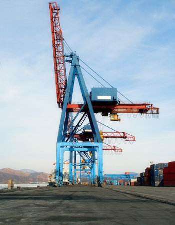 Cargo dock crane with stacks of containers photo