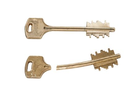 isoleted: golden broken key on white background isoleted