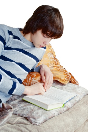 guy laying on the sofa and reading a book photo