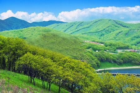 A photograph of mountain scenery japan sea. photo