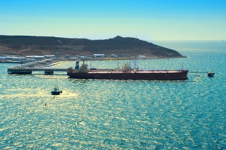 Tanker loading oil in the sea port Stock Photo