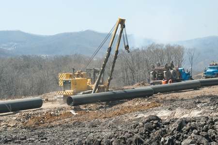 Preparing for pulling the pipeline through a water barrier. Stock Photo - 9322302
