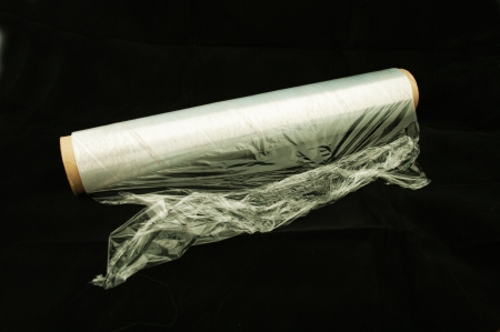 plastic wrap: Kitchen film separately on a black background