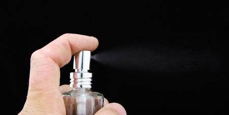 close-up of perfume spraying