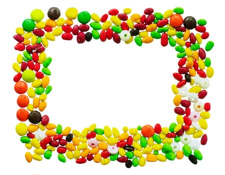 frame of multi-colored candies on white background photo