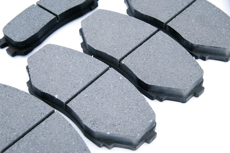 A   grey  textured Disc Brake Pads  background