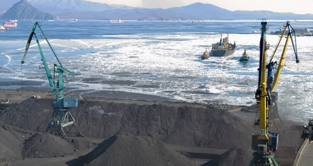 uploaded: The port terminal for coal loading sailing ship an uploaded coal in port  Nakhodka