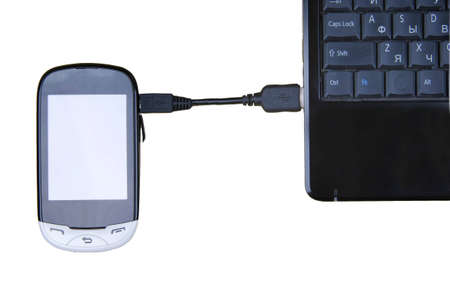 Connect. Laptop and cell phone concept on white background. Stock Photo - 12514335
