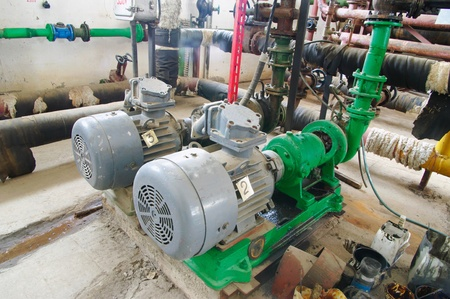 Water pumping station, industrial interiorelectric water pump  and pipes photo