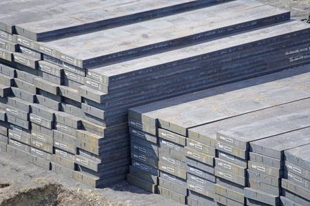 ingots: Warehouse heavy  steel ingots in the port