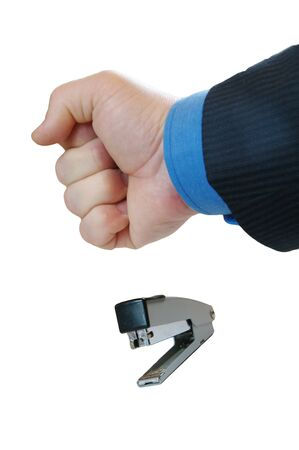 hand clenched into a fist hits the stapler Stock Photo - 13607968