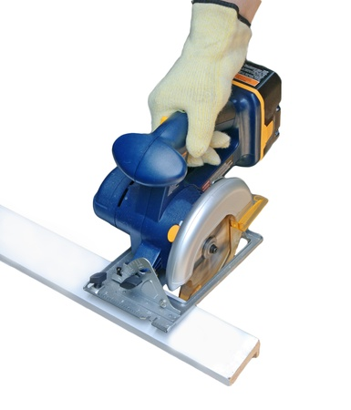 carpenter cutting wood with battery saw,  for furniture. Stock Photo - 14763080