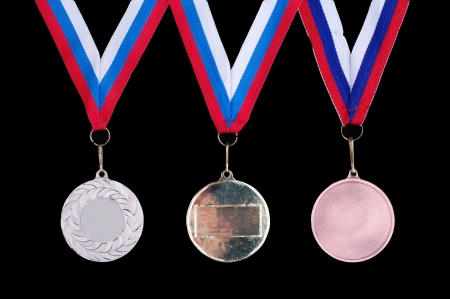 Three medals, Gold, Silver and bronze for the winners on the black background photo