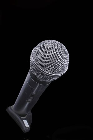microphone on a stand on black background photo