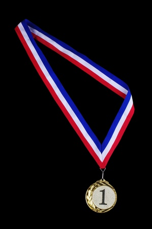 Gold medal with ribbon isolated on black background
