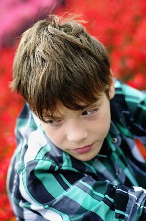 boy at 12st old in  green plaid shirt