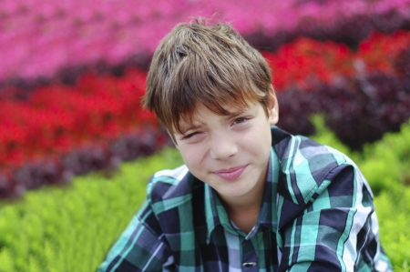 Young Boy in a Plaid Shirt Looking Directly to the Camera