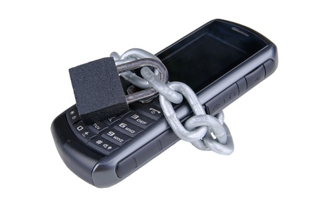 cell phone wrapped in a chain with a padlock Stock Photo - 17173337