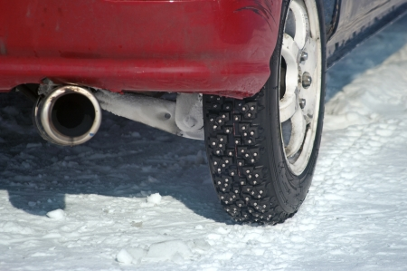 winter tire on sport car    the  snow  background photo