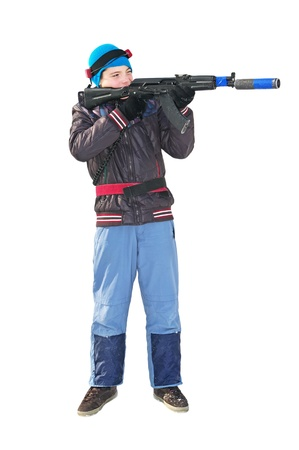boy in winter clothes with a machine gun to play laser tag photo