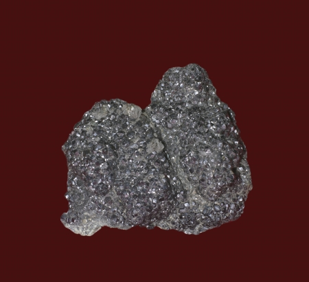 magnetite: crystals of Magnetite mineral isolated on red background