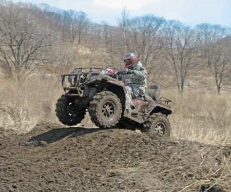 extreme terrain: atv racing on dirt track at spring Stock Photo