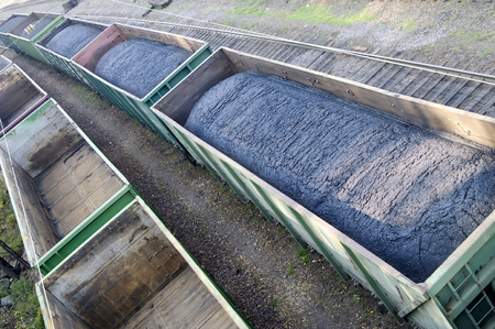 train loaded with coal, next to the empty wagons Stock Photo - 23199071