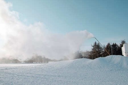 water  skier: Snow machine gun produces snow for the construction of the New Year for the rolling hills
