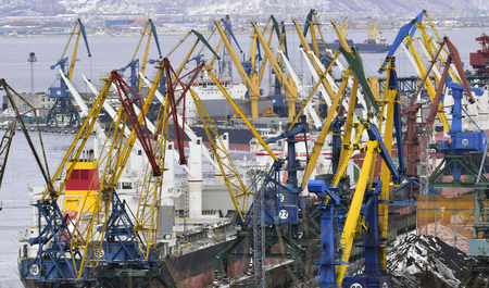 loads: Marine cranes loads  on a cargo ship. The storage area for loads Sea transportation of cargo