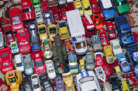 neatly: Various colorful toy cars in  traffic jam Stock Photo