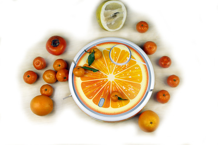 The automated robot vacuum cleaner stylized orange fruit on a background on a white Stock Photo