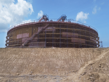 New constructed storage tank for oil on sky