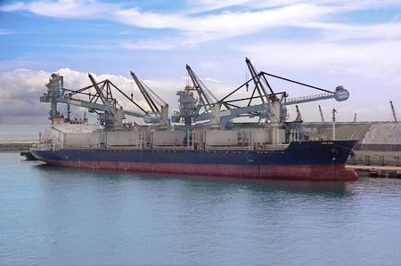 cargo ship loading in coal cargo terminal