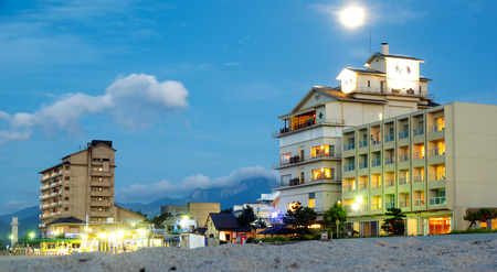 hotels on the seafront, view of the mountain of daisen , Kaike onsen, Yonago,Japan 9.07.2017 Editorial