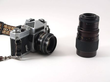Old film SLR and zoom lens, logos removed