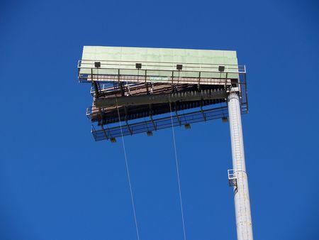 Empty billboard on a high pole