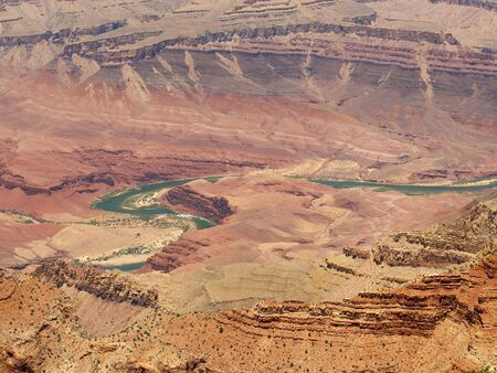 Colorado River winding thru the Grand Canyon, seen from Lipan Point Imagens