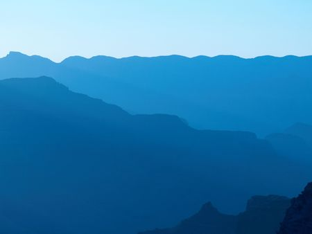 Grand Canyon silhouetted against morning sunlight