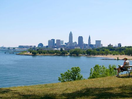 Downtown Cleveland, Ohio, with Lake Erie, beach, and reader